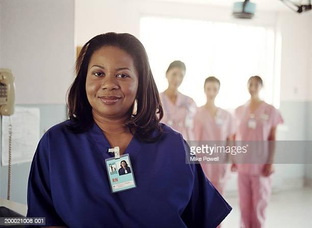Hospital nurses, focus on nurse in blue uniform