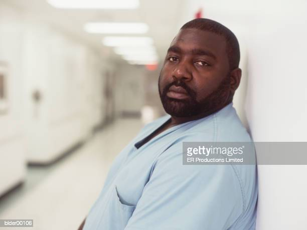 a hospital orderly in a hospital corridor - fat black man stock photos and pictures