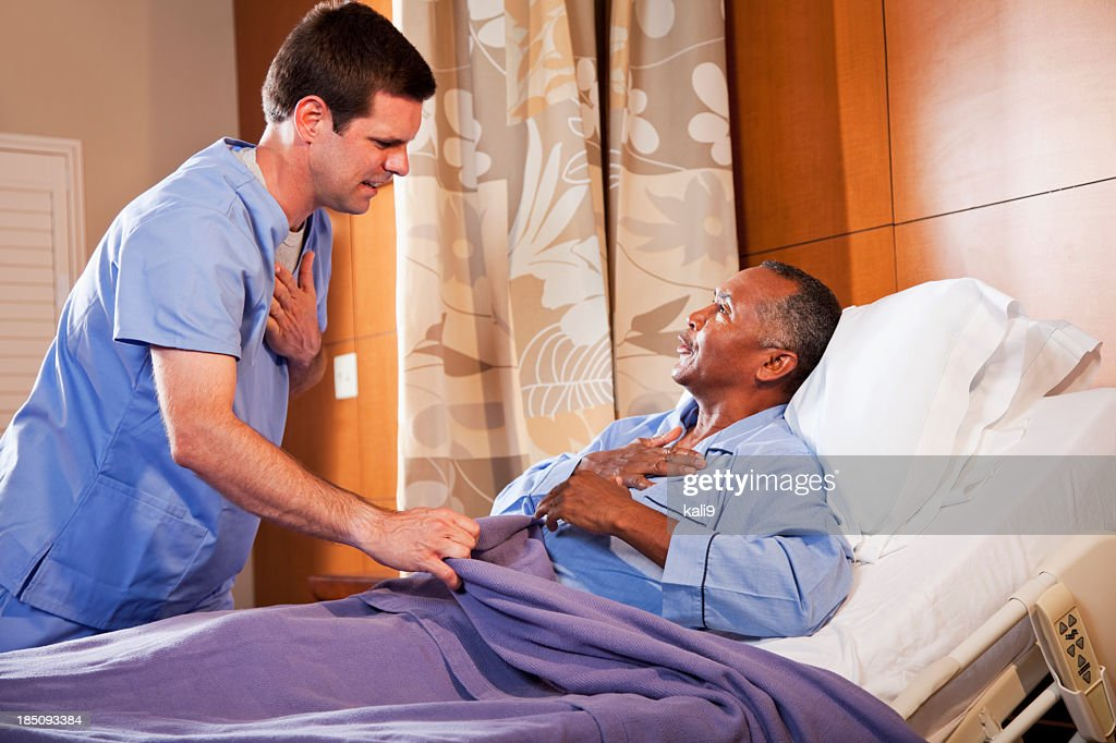 Hospital Orderly Talking With Senior Patient Stock Photo Getty Images