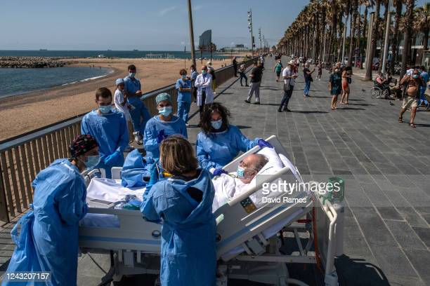 Hospital patient Isidre Correa is taken to the seaside by intensive health care staff outside the Hospital del Mar on June 03 2020 in Barcelona Spain...