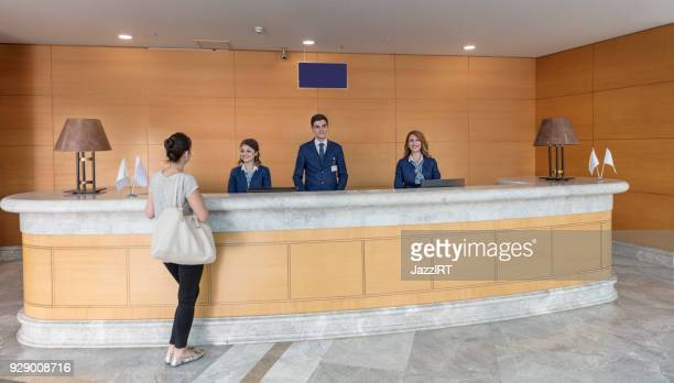 hospital patient reception desk - receptionist stock pictures, royalty-free photos & images