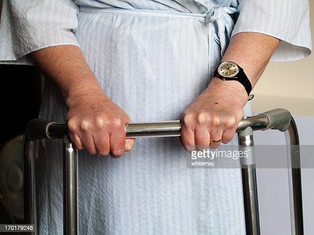 hospital patient with walking frame - skin scab stock photos and pictures