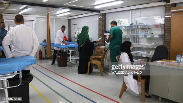Hospital personnel receive patients at the alJamhuri hospital complex in the northern city of Mosul on September 9 2018 Two hospitals reopened in...