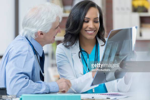 Hospital physicians studying patient's x-ray together