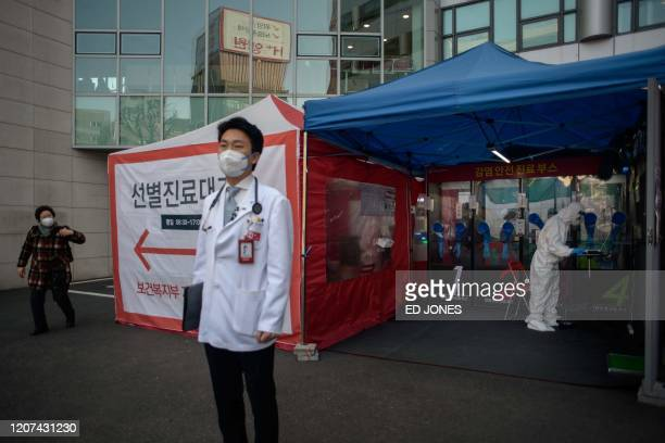 Hospital president Kim Sang-il stands outside a COVID-19 novel coronavirus testing booth at Yangji hospital in Seoul on March 17, 2020. - A South...