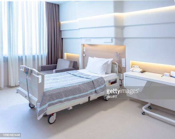 hospital room with beds and comfortable medical equipped - hospital ward stock pictures, royalty-free photos & images