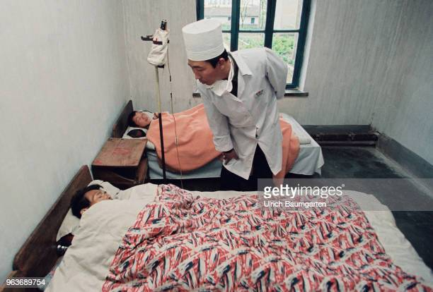 Hospital room with patient and a doctor in a hospital in Hwasan