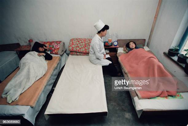 Hospital room with patients and a female doctor in a hospital in Hwasan