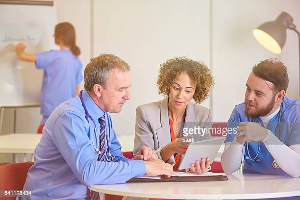 hospital senior staff meeting - administrator stock pictures, royalty-free photos & images
