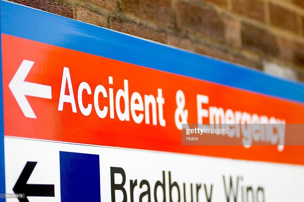 Hospital sign pointing to accident & emergency : Stock Photo