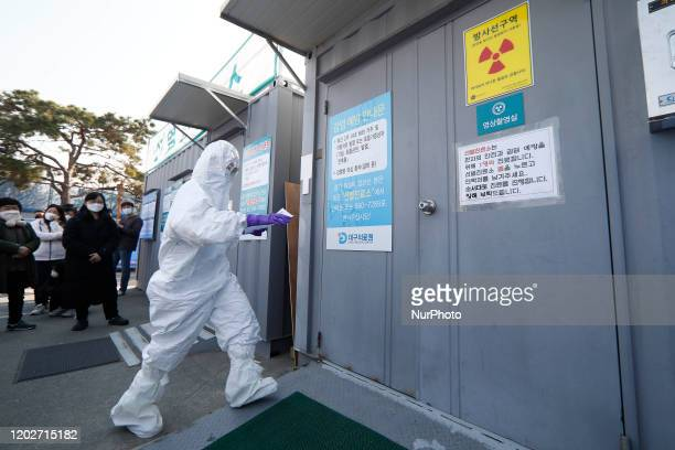 Hospital Staff carrying Covid19 suspect case blood sample at medical center in Daegu, South Korea, on February 23, 2020. South Korea's confirmed...
