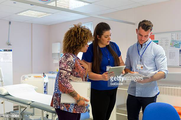 Hospital staff discussing patients medical results
