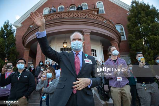 Hospital staff including Philip Wilner at the New YorkPresbyterian Behavioral Health Center wave and applaud as a caravan of emergency vehicles...