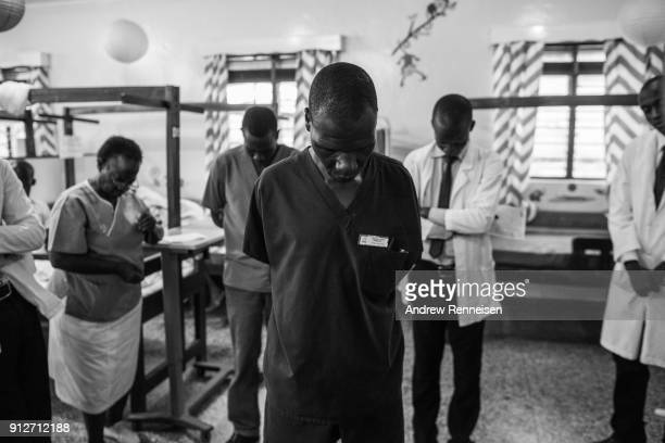 Hospital staff pray to start the day at Cure Hospital on February 6 2017 in Mbale Uganda SubSaharan Africa has only one neurosurgeon for every 10...
