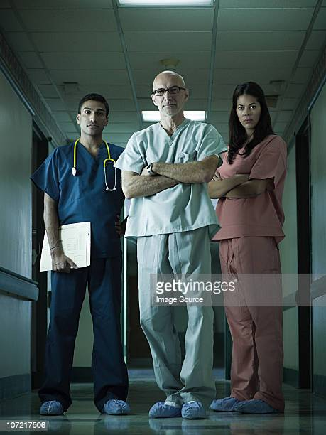 hospital staff standing in corridor - shoe covers stock pictures, royalty-free photos & images