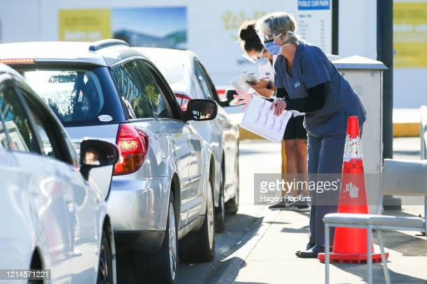 Hospital staff talk to arrivals at Wellington Hospital ahead of a nationwide lockdown on March 25, 2020 in Wellington, New Zealand. New Zealand will...