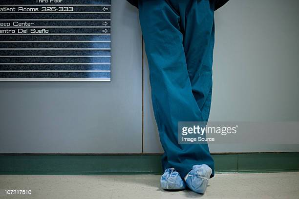 Hospital surgeon wearing shoe protectors, low section