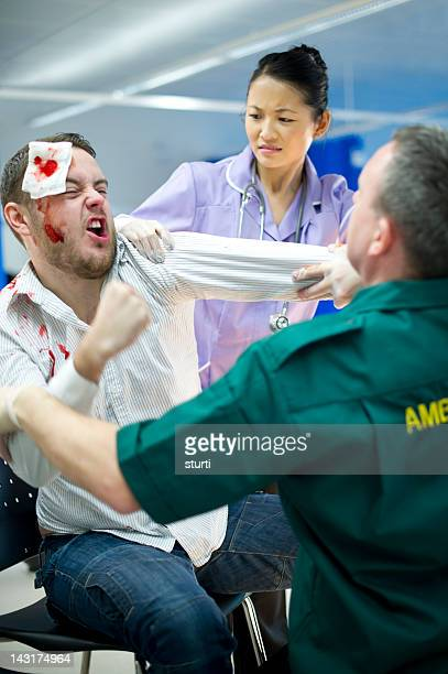 hospital violence - violence stock photos and pictures