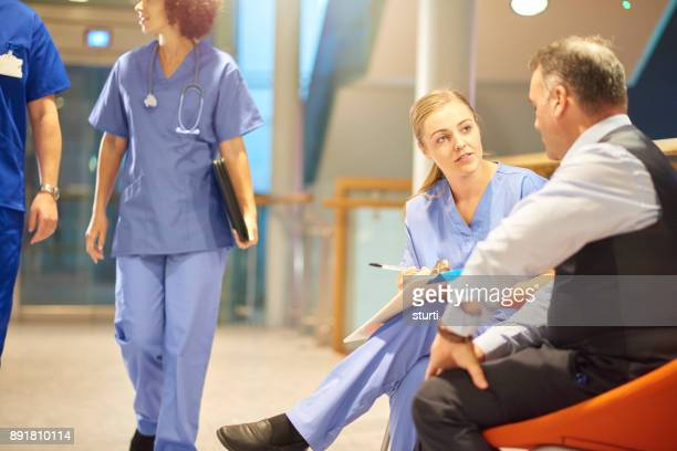 hospital ward chat - outpatient care stock pictures, royalty-free photos & images