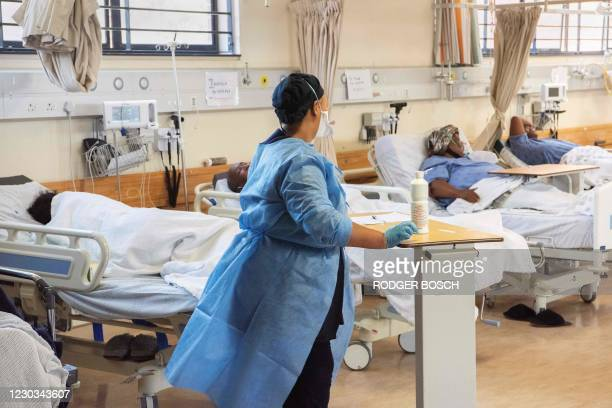 Hospital worker walks amongst patients with COVID-19 in the COVID-19 ward at Khayelitsha Hospital, about 35km from the centre of Cape Town, on...