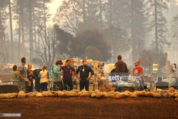 Hospital workers at the Feather River Hospital work in a triage area while evacuating patients as the Camp Fire moves through the area on November 8...