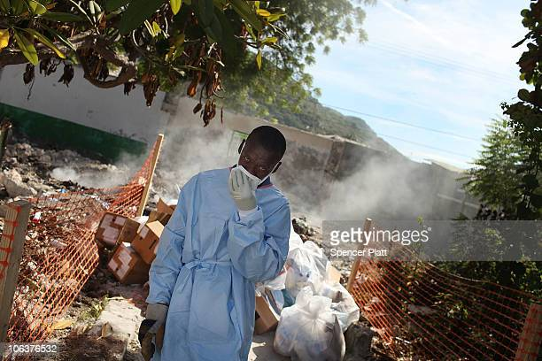Hospital workers burn medical waste behind a hospital that is treating cholera patients October 30 2010 in St Marc Haiti Haiti one of the poorest...