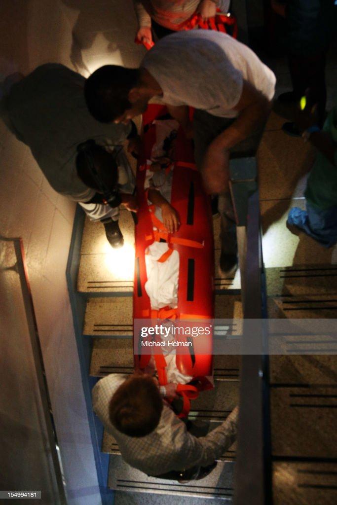 Hospital workers evacuate patient Deborah Dadlani from NYU Langone