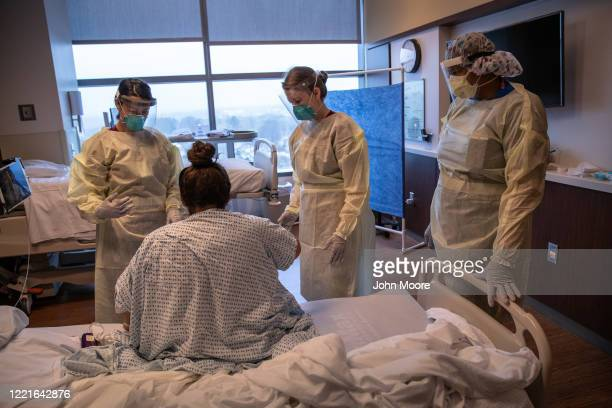 Hospital workers prepare COVID19 patient and Guatemalan asylum seeker Zully to take her first steps after being removed from a ventilator at a...