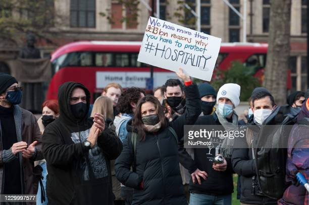 Hospitality workers take part in a demonstration in Parliament Square urging the government to revise its policies relating to tiered coronavirus...