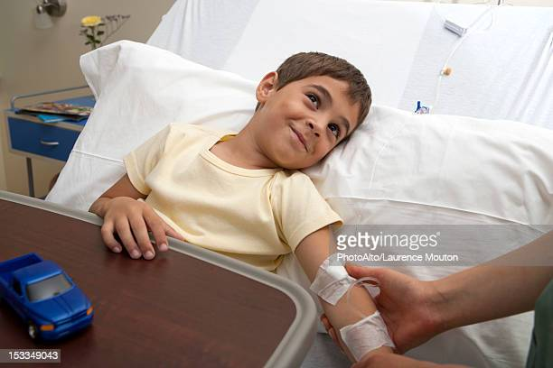 hospitalized by being comforted by out-of-frame adult - out of frame stock pictures, royalty-free photos & images
