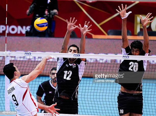 Hossam Abdalla and Abd Elhalim of Egypt defend against Carlos Guerra of Mexico during the FIVB World Championships match between Egypt and Mexico on...