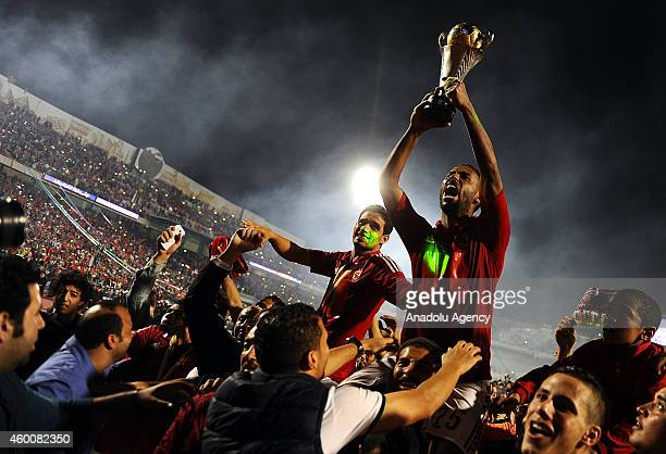 Hossam Ashour of AlAhly holds the trophy after the victory against Sewe Sport within the second leg of the CAF Confederation Cup final football match...