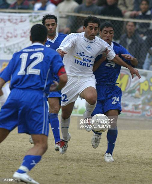 Hossam Fawzi of Baghdad's alZawra club is challenged by Fawzi Abdel Sadeh of rival Baghdad team alTalaba during the final of the Baghdad Cup 05...