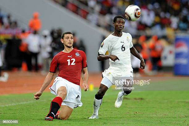 Hossam Ghali of Egypt and Anthony Annan of Ghana during the Africa Cup of Nations final match between Ghana and Egypt from November 11 Stadium on...