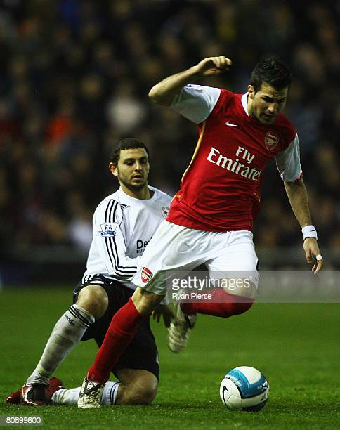 Hossam Ghaly of Derby County challenges Cesc Fabregas of Arsenal during the Barclays Premier League match between Derby County and Arsenal at Pride...