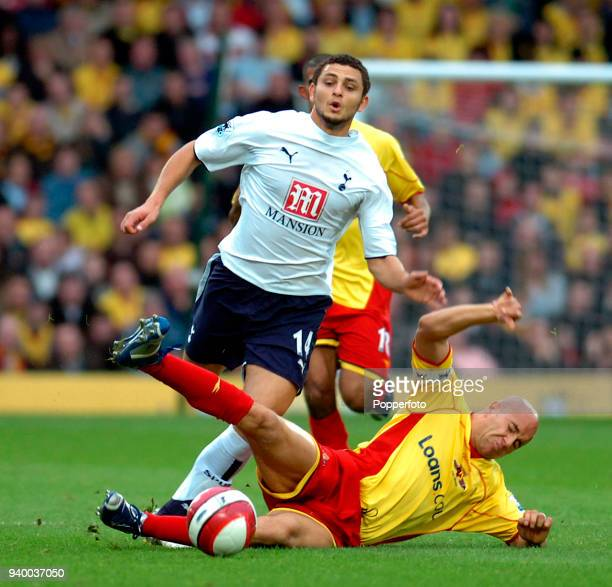 Hossam Ghaly of Tottenham Hotspur is tackled by Gavin Mahon of Watford during the Barclays Premiership match between Watford and Tottenham Hotspur at...