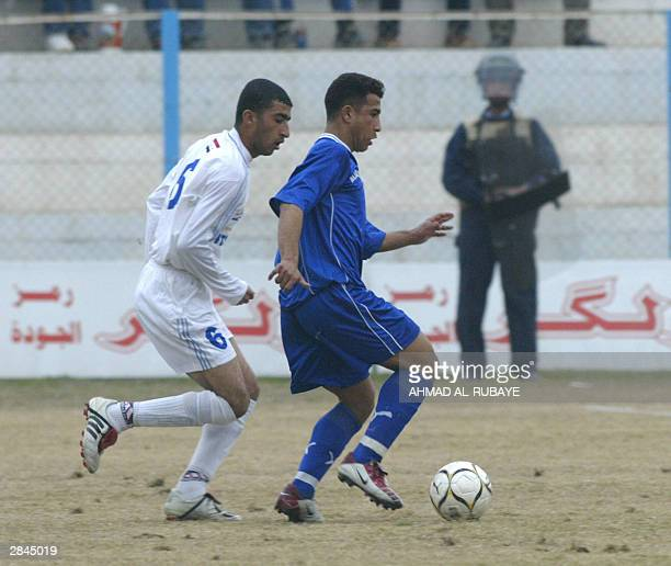 Hossam Kadem of Baghdad's alZawra club chases an unidentified player of rival Baghdad team alTalaba during the final of the Baghdad Cup 05 January...