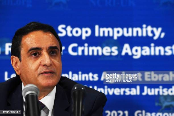 Hossein Abedini, National Council of Resistance of Iran foreign affairs committee member, speaks during a press conference organised by The UK...