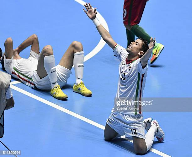 Hossein Tayebi of Iran celebrates after winning the third place after the FIFA Futsal World Cup Third Place Play off match between Iran and Portugal...