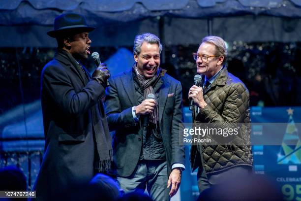 Host A J Calloway with Stars of Bravo's 'Get a Room with Carson Thom' Thom Felicia and Carson Kressley on stage as the New York Stock Exchange...
