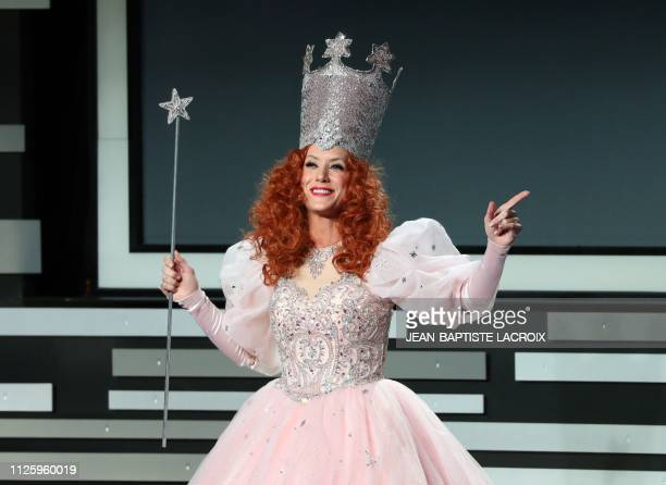 Host actress Kate Walsh appears on stage dressed as Glinda the Good Witch of the South from The Wizard of Oz at the 21st Costume Designers Guild...