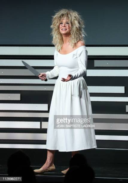 Host actress Kate Walsh dressed as Glenn Close in Fatal Attraction speaks on stage during the 21st Costume Designers Guild Awards at The Beverly...