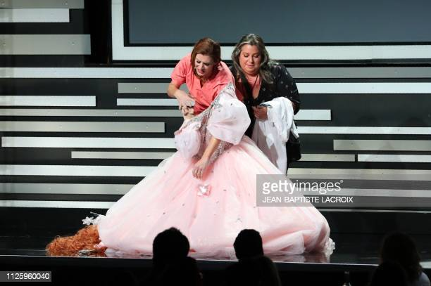 Host actress Kate Walsh gets help removing her Glinda the Good Witch of the South from The Wizard of Oz costum to appear wearing scrubs like she did...