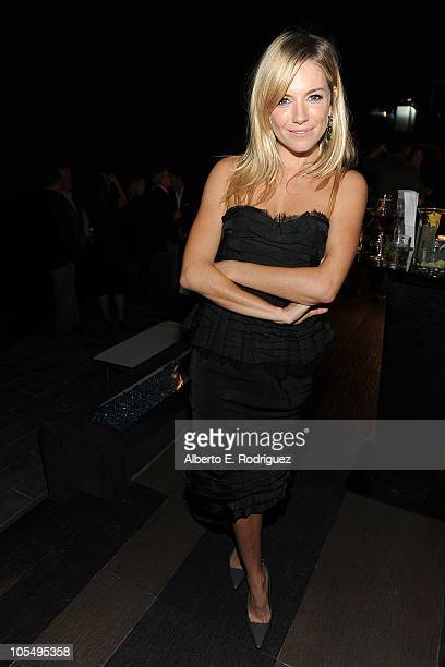 Host actress Sienna Miller arrives at the Grand Opening of Esquire House LA to benefit International Medical Corps at The Esquire House on October 15...
