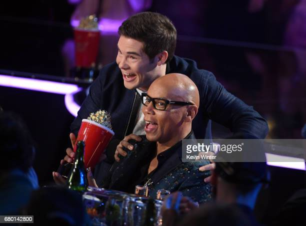 Host Adam Devin presents the Best Reality Competition award to RuPaul for RuPaul's Drag Race in the audience during the 2017 MTV Movie And TV Awards...