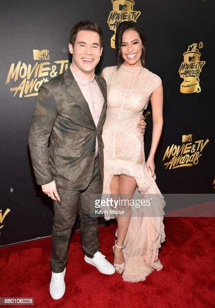 Host Adam DeVine and actor Chloe Bridges attend the 2017 MTV Movie And TV Awards at The Shrine Auditorium on May 7 2017 in Los Angeles California