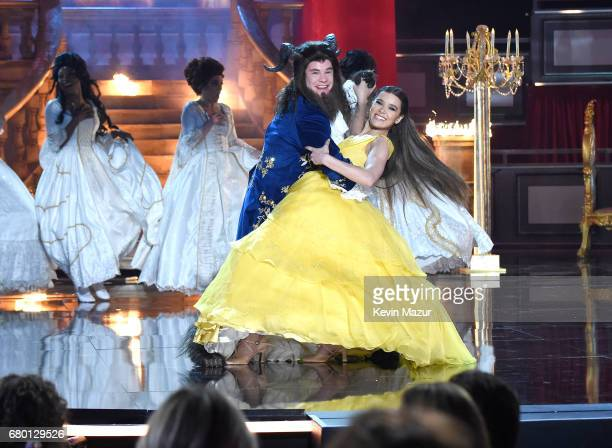 Host Adam DeVine and actorrecording artist Hailee Steinfeld perform onstage during the 2017 MTV Movie And TV Awards at The Shrine Auditorium on May 7...