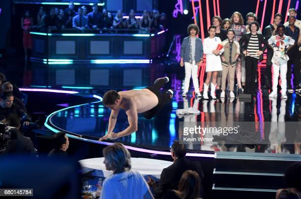 Host Adam DeVine onstage with cast of 'Stranger Things' during the 2017 MTV Movie And TV Awards at The Shrine Auditorium on May 7 2017 in Los Angeles...