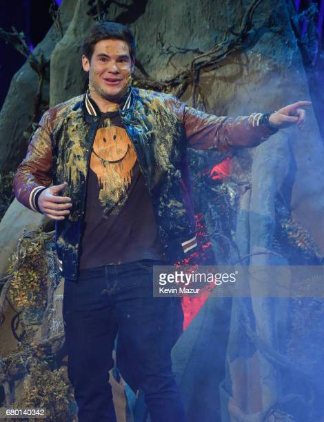 Host Adam DeVine speaks onstage during the 2017 MTV Movie And TV Awards at The Shrine Auditorium on May 7 2017 in Los Angeles California