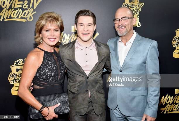 Host Adam Devine with parents Penny Devine and Dennis Devine attends the 2017 MTV Movie And TV Awards at The Shrine Auditorium on May 7 2017 in Los...